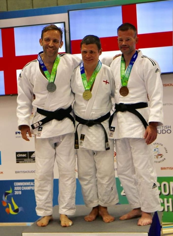 Carl Holland Pictured Centre Winning Gold