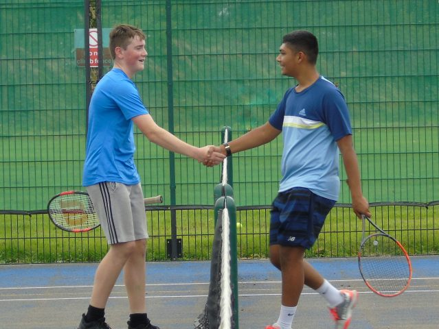 Alfie Kingham and Jarnel Dhillon shaking hands